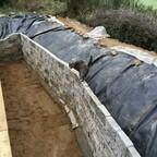 53 Granitmauer für die Tiefwasserzone